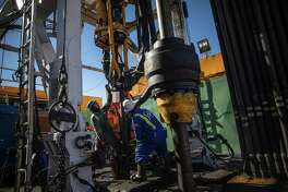 Floorhands work on an drilling rig contracted to Shell in the Delaware Basin, near Wink, Texas, on Jan. 25, 2019. Innovation, investment and inviting geology have given new life to an oil patch that once seemed spent. The Permian Basin is now the world's second most productive. (Tamir Kalifa/The New York Times)