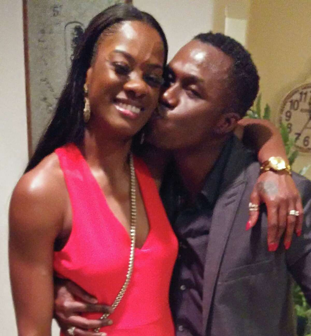 Andre McDonald kisses wife Andreen McDonald during his 40th birthday party in February. Andreen McDonaldl disappeared March 1 and is presumed dead by law enforcement officials.