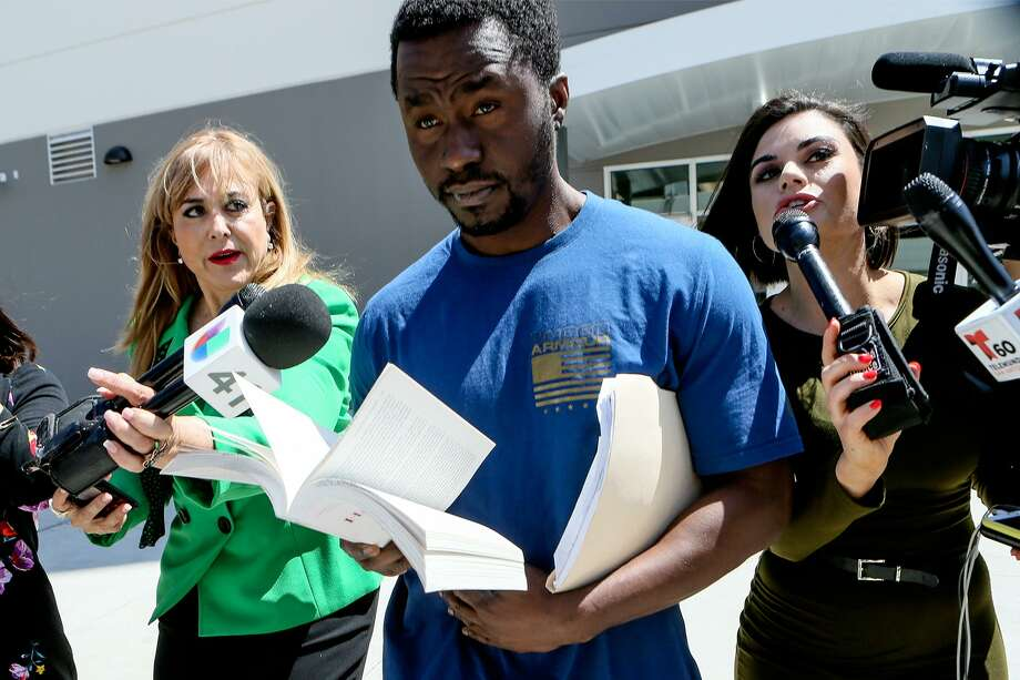 Andre McDonald, left, is released from the new Justice Intake Center at the Bexar County Jail on Tuesday, April 2, 2019, after posting bond of $300,000. McDonald is charged with tampering in his wife's disappearance in March. Photo: Marvin Pfeiffer, Staff Photographer / Express-News 2019