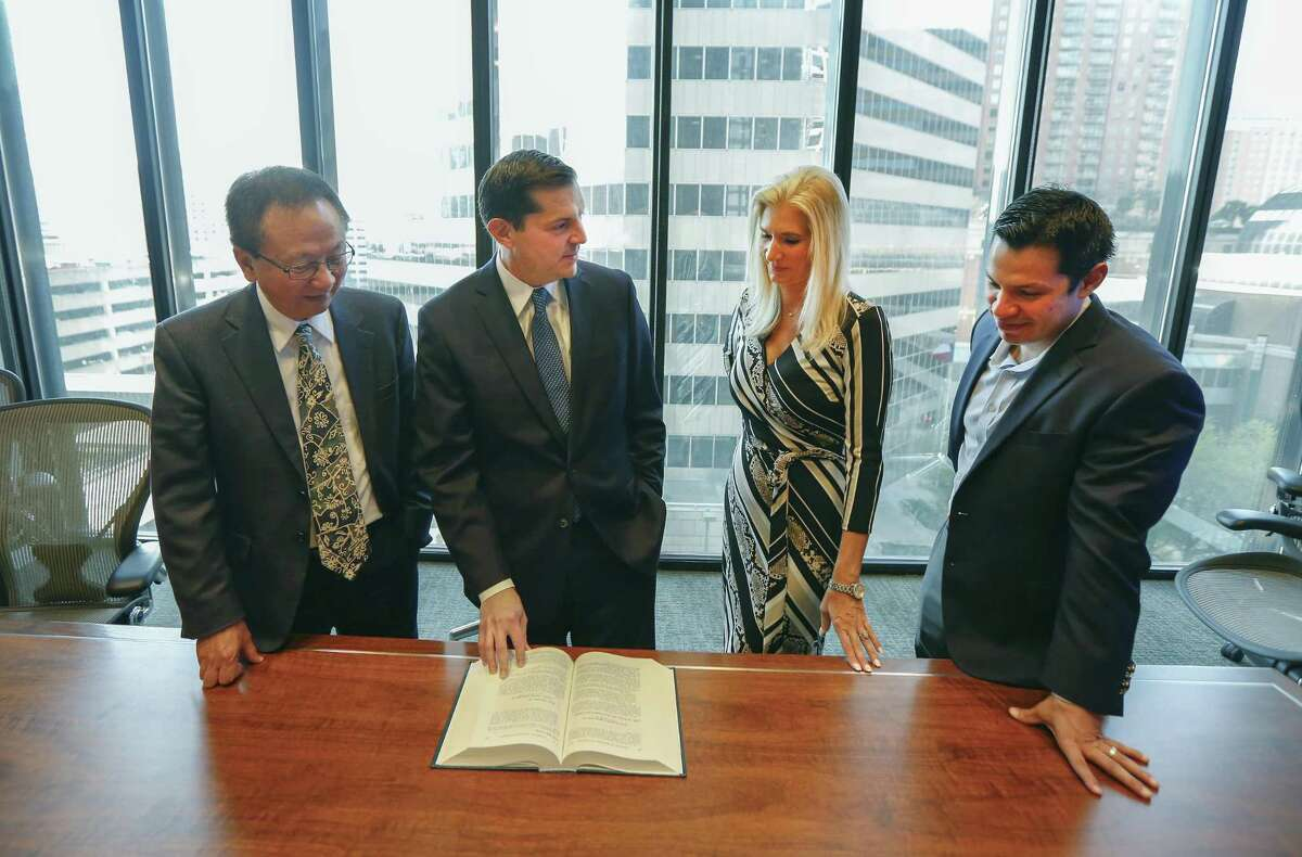 Andrew C. Gratz, Associate General Counsel, LyondellBasell (second from left) talks to colleagues Shao Guo (left-right), Aimee Cade and Armando Gonzales Tuesday, March 26, 2019, in Houston.
