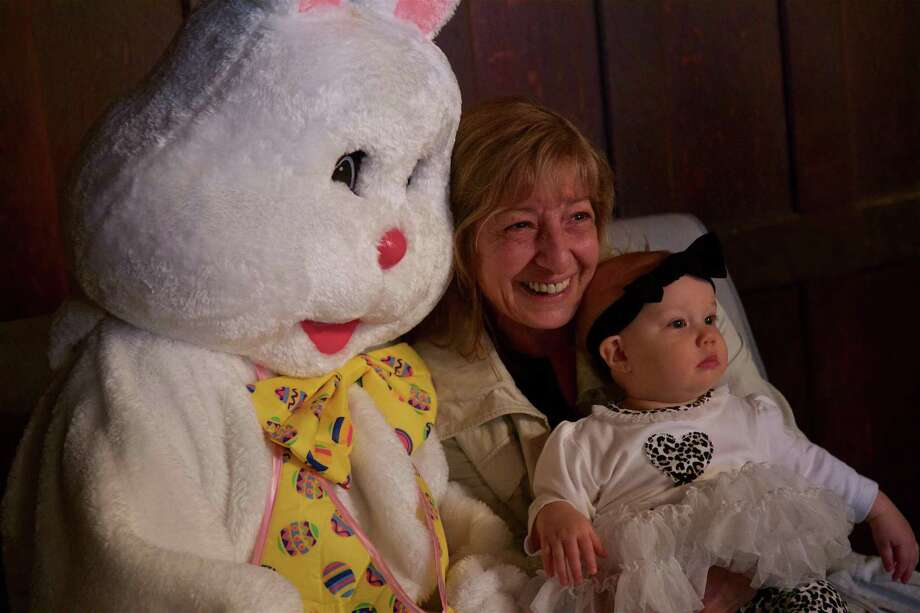 Proud grandmother Jenette D'Alessandro of New Canaan enjoys her granddaughter, Cosette Gibba, 9 months, of Westport, and her first meeting with the Easter Bunny Saturday, April 13, at Waveny House. Photo: Jarret Liotta/ / For Hearst Connecticut Media / Connecticut Post