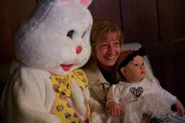 Proud grandmother Jenette D'Alessandro of New Canaan enjoys her granddaughter, Cosette Gibba, 9 months, of Westport, and her first meeting with the Easter Bunny Saturday, April 13, at Waveny House.