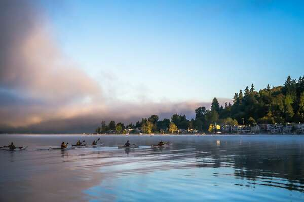 Early morning kayakers glide on Lake Sammamish.