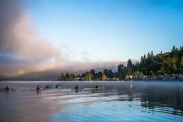 Early morning kayakers glide on Lake Sammamish.