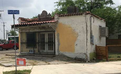A former ice house and gas station space that dates back to the 1920s at 419 S. Hackberry St. has received special historic landmark designation and will be transformed into a coffee house that serves beer and wine.