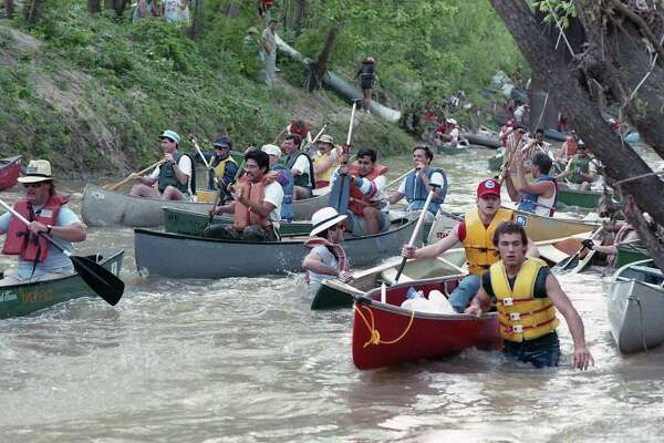 "Canoes and ""anything that floats"" make their way down Buffalo Bayou during the 20th annual Reeking Regatta, April 8, 1989."