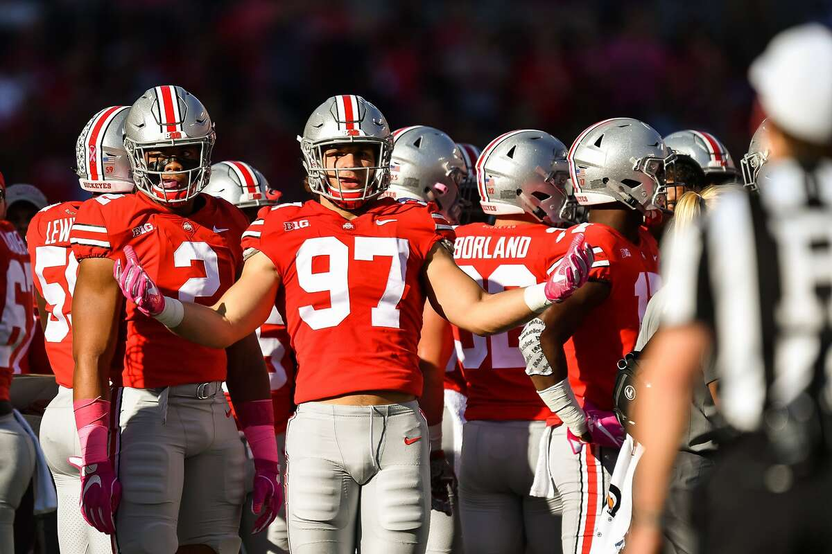 COLUMBUS, OH - OCTOBER 7: Nick Bosa #97 of the Ohio State Buckeyes asks for an explanation on a penalty from the referee during a game against the Maryland Terrapins at Ohio Stadium on October 7, 2017 in Columbus, Ohio. ~~