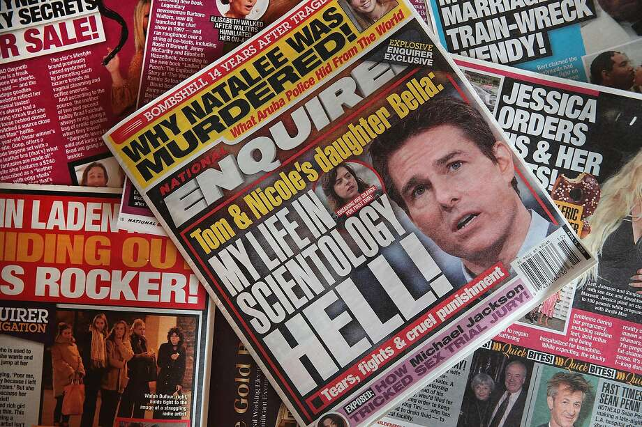 CHICAGO, ILLINOIS - APRIL 11: In this photo illustration, celebrity gossip dominates the cover of a National Enquirer magazine on April 11, 2019 in Chicago, Illinois. American Media Inc., the parent company of the National Enquirer has put the magazine and some of their other tabloids up for sale. (Photo Illustration by Scott Olson/Getty Images) Photo: Scott Olson / Getty Images
