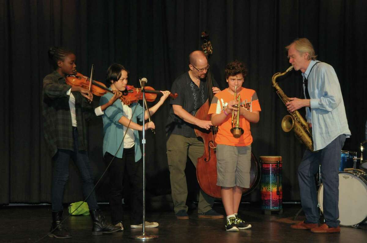 Bernie Wallace, right, plays with students at the BackCountry Jazz Summer Music Camp held at Barnum School in Bridgeport, Conn. on Friday, July 17, 2015.