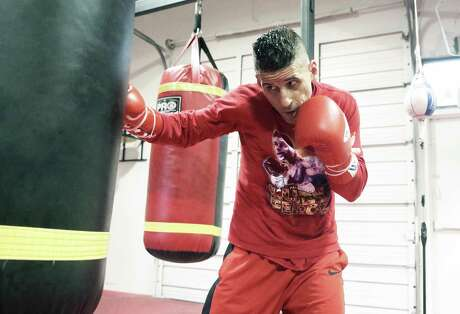 Luis Villarreal works out at his training gym on Bandera Road on April 17, 2019.