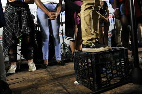 10-year-old Langston Saint, of Sioux City, Iowa, stands on a crate while speaking during the Road to Change Tour at the Fairfield Hills Campus in Newtown, Conn. on Sunday, Aug. 12, 2018. March for Our Lives, which was created by student survivors of the Stoneman Douglas High School shooting, joined local activist group Sandy Hook Promise and various other activists on the last stop of their 80-city tour.