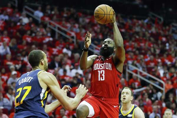 Houston Rockets guard James Harden (13) shoots over Utah Jazz center Rudy Gobert (27) during the second half of game 2 during the NBA playoffs at the Toyota Center in Houston, Wednesday, April 17, 2019.
