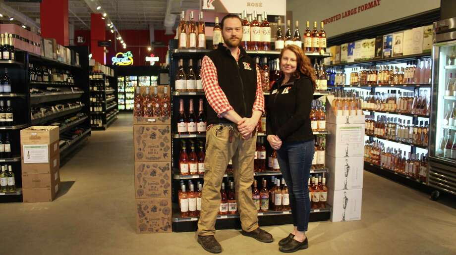 Lori Brower (right), general manager of the Westport Kindred Spirits & Wines, stands in the empty store on April 18 with her colleague. Photo: Sophie Vaughan / Hearst Connecticut Media / Westport News