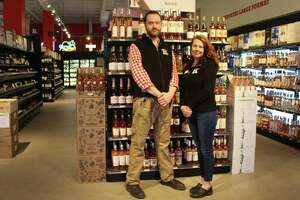 Lori Brower (right), general manager of the Westport Kindred Spirits & Wines, stands in the empty store on April 18 with her colleague.