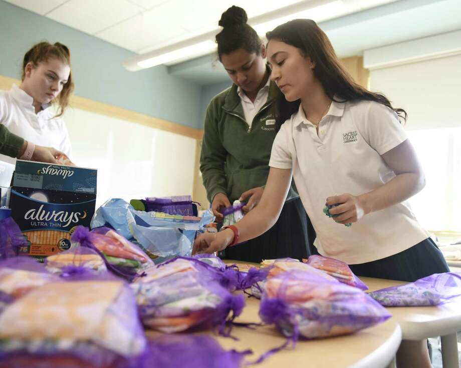 Students sort tampons and pads into care packages at Sacred Heart Greenwich in Greenwich, Conn. Wednesday, April 17, 2019. Sacred Heart sisters Stephanie and Caroline Guza organized the drive that helped supply more than 4,000 tampons and 2,000 pads to underserved women in Fairfield and Westchester Counties. Photo: Tyler Sizemore / Hearst Connecticut Media / Greenwich Time
