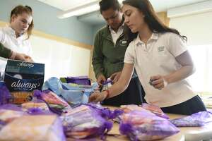Students sort tampons and pads into care packages at Sacred Heart Greenwich in Greenwich, Conn. Wednesday, April 17, 2019. Sacred Heart sisters Stephanie and Caroline Guza organized the drive that helped supply more than 4,000 tampons and 2,000 pads to underserved women in Fairfield and Westchester Counties.