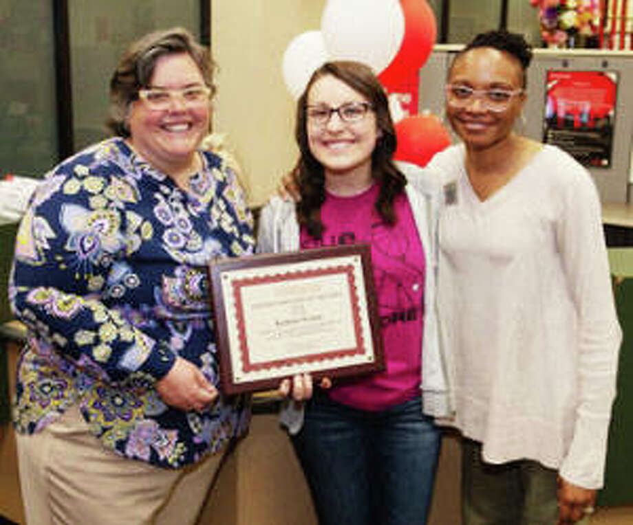 Kristen Woods, center, a SIUE junior majoring in corporate and organizational communications, was named the 2019 Student Employee of the Year. Congratulating her are Denise Cobb, provost and vice chancellor for academic affairs, left, and Vivian Rodgers, office support associate for the Kimmel Student Involvement Center, who nominated Woods.