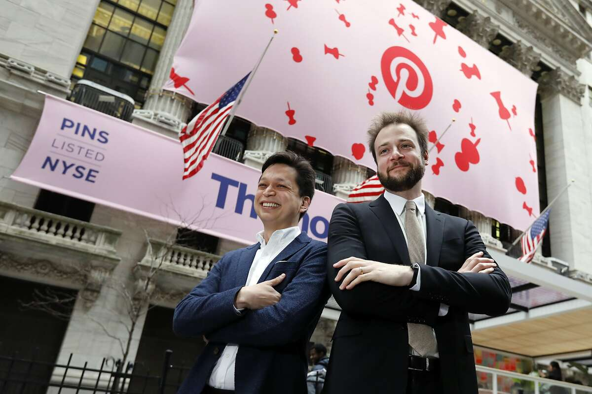 Pinterest co-founder & CEO Ben Silbermann, left, and fellow co-founder and chief product officer Evan Sharp, pose for photos outside the New York Stock Exchange, Thursday, April 18, 2019, before the company's IPO.