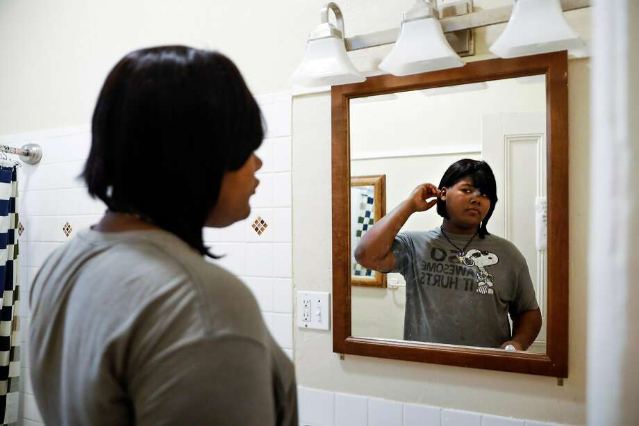 Kat Blackburn, who lives in the nation's first long-term transitional living program specifically for transgender homeless young people, looks in the mirror after brushing her teeth. Photo: Gabrielle Lurie / The Chronicle