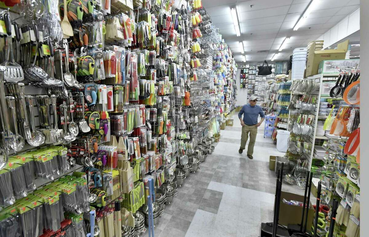 Robert Randy of Orange searches for kitchen items Wednesday at the new Dollar & Dreamstore in West Haven.