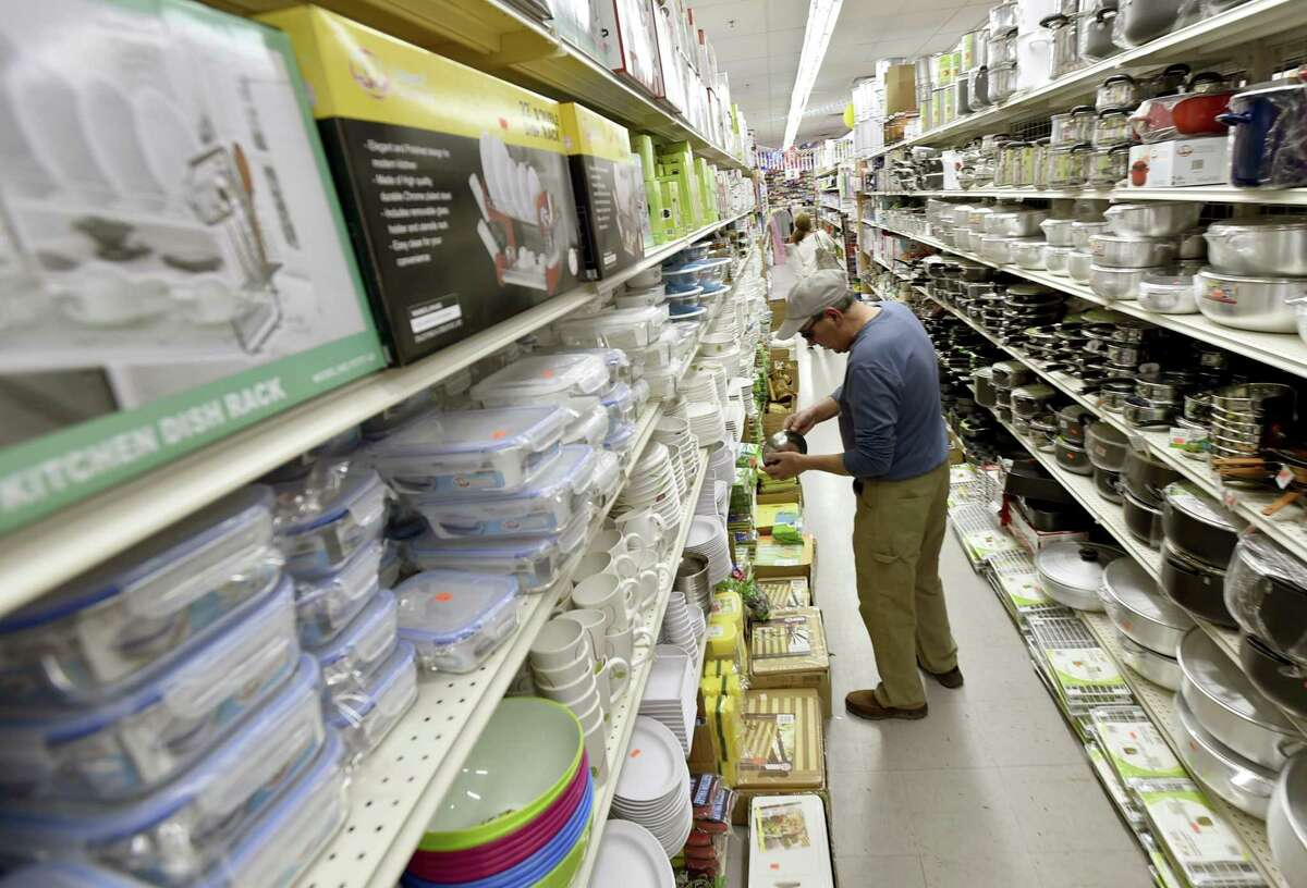 Robert Randy of Orange searches for kitchen items Wednesday at the new Dollar & Dream store in West Haven.