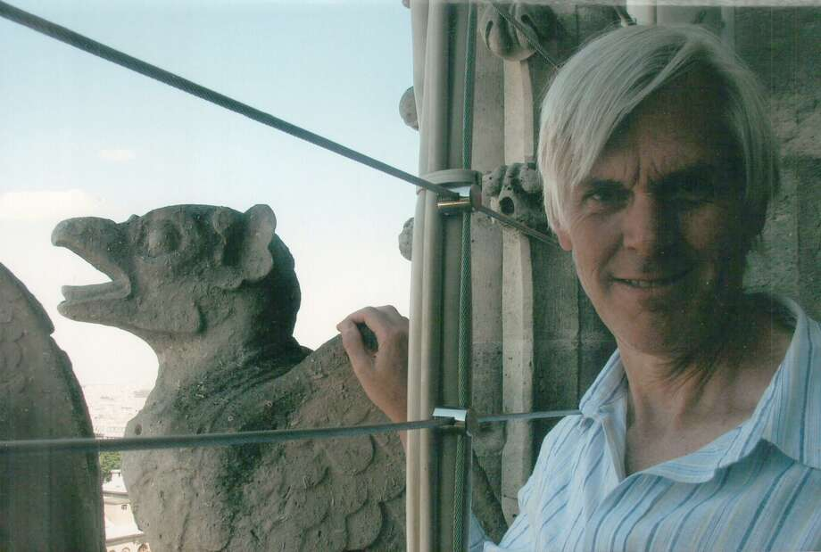Columnist Randall Beach next to one of the fabled stone creatures atop Notre Dame Cathedral in Paris during a family trip a few years ago. Photo: Randy Beach Family Photos /