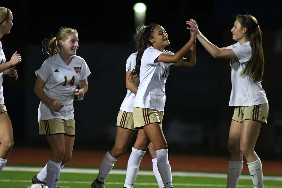 Cy Woods junior forward Kiran Singh, center, celebrates her goal scored against Cy Ranch with teammates during the first period of their District 14-6A matchup at LCHS on Match 15, 2019. Photo: Jerry Baker, Houston Chronicle / Contributor / Houston Chronicle