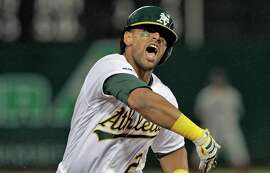 Khris Davis (2) reacts as he rounds the base following his solo homerun in the second inning as the Oakland Athletics played the Boston Red Sox at the Coliseum in Oakland, Calif., on Monday, April 1, 2019.