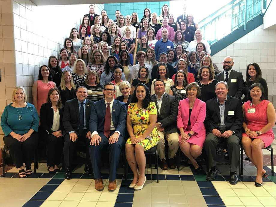 The 68 teachers of the year take a moment with the Katy ISD board. Katy ISD honored its campus teachers of the year during a luncheon Thursday, April 18, 2019, at the Merrell Center. Photo: Michelle Iracheta / Staff Photo