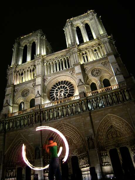 PARISTRAVEL_017_dj.jpg  Street performers outside the cathedral at Notre Dame after midnight on May 16, 2007 in Paris.  Dan Jung / The Chronicle
