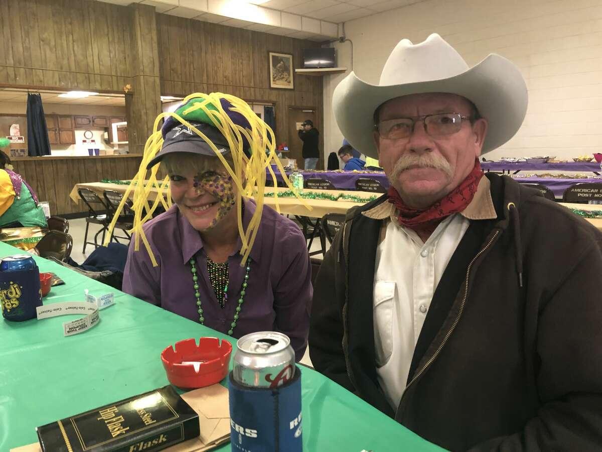 Mardi Gras: Janice Pineda, left, and Gary Birkenfeld