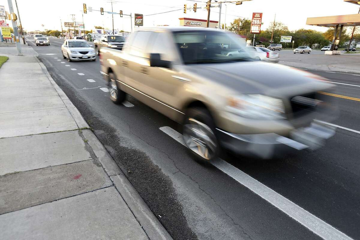 A vehicle drives on the bike lane at the intersection of West Commerce Street and S.W. 24th Street. The city should take prominent action to protect cyclists from careless drivers.