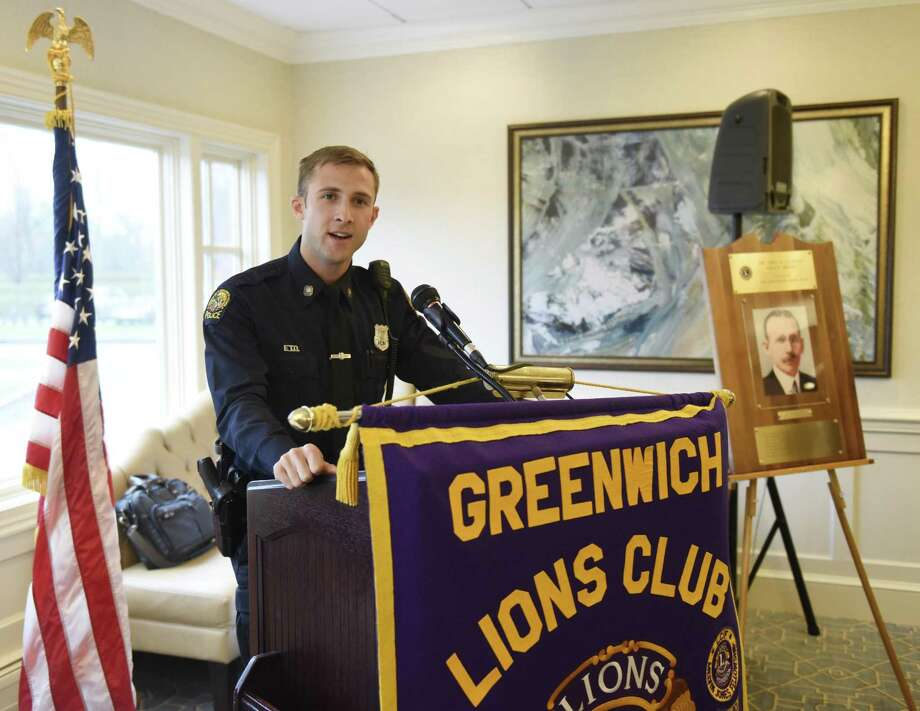 """Patrol Officer Ryan Beattie accepts his award at the annual John A. Clarke Memorial Award Luncheon at Innis Arden Golf Club in Old Greenwich, Conn. Thursday, April 18, 2019. Hosted by the Greenwich Lions Club, the ceremony named Patrol Officer Ryan Beattie """"officer of the year"""" with highlights including a traffic stop that yielded a substantial haul of hard drugs, rescuing a heart-attack victim and working a Greenwich Avenue retail-crime task force that racked up 85 felony charges. Photo: Tyler Sizemore / Hearst Connecticut Media / Greenwich Time"""
