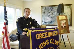 "Patrol Officer Ryan Beattie accepts his award at the annual John A. Clarke Memorial Award Luncheon at Innis Arden Golf Club in Old Greenwich, Conn. Thursday, April 18, 2019. Hosted by the Greenwich Lions Club, the ceremony named Patrol Officer Ryan Beattie ""officer of the year"" with highlights including a traffic stop that yielded a substantial haul of hard drugs, rescuing a heart-attack victim and working a Greenwich Avenue retail-crime task force that racked up 85 felony charges."