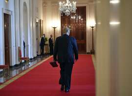 US President Donald Trump departs with a statuette after speaking at an event honoring the Wounded Warrior Project Soldier Ride in the East Room of the White House in Washington, DC on April 18, 2019. (Photo by MANDEL NGAN / AFP)MANDEL NGAN/AFP/Getty Images