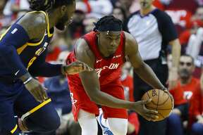Houston Rockets forward Danuel House Jr. (4) drives past Utah Jazz forward Jae Crowder (99) during the second half of game 2 during the NBA playoffs at the Toyota Center in Houston, Wednesday, April 17, 2019.