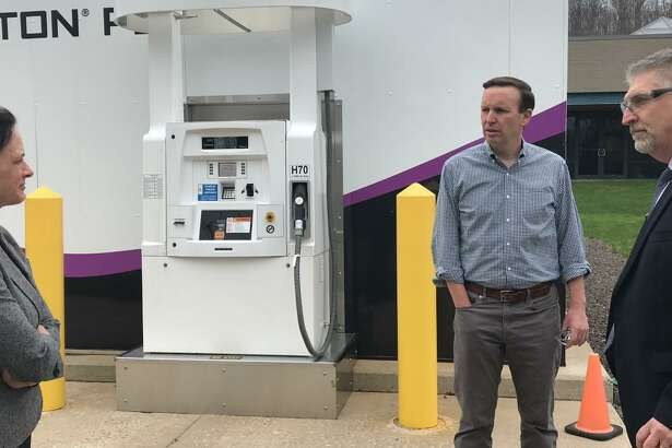 U.S. Sen.Chris Murphy talks with John Zagaja III, senior vice president of operations at Wallingford-based Proton OnSite, and Kathy Ayers, the company's vice president of research and development, outside the company's headquarters at one of Proton OnSite's refueling stations for hydrogen-powered vehicles.