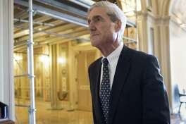 In this June 21, 2017, file photo, special counsel Robert Mueller departs after a meeting on Capitol Hill in Washington. A redacted version of Mueller's Russia report was released Thursday.