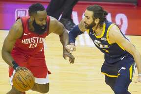 Houston Rockets guard James Harden (13) drives against Utah Jazz guard Ricky Rubio (3) during the first half of game 2 of the NBA playoffs at the Toyota Center in Houston, Wednesday, April 17, 2019.