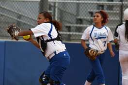Dekaney catcher Alexa Villa, left, makes a play against Spring with backup from first baseman Tatiana Villa (7) during the top of the 4th inning of their District 16-6A matchup at Dekaney High School on April 12, 2019.