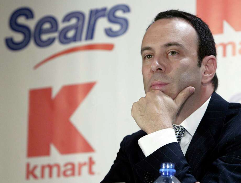 FILE- In this Nov. 17, 2004, file photo Kmart chairman Edward Lampert listens during a news conference to announce the merger of Kmart and Sears in New York. Sears Holdings Corp. is suing its former chairman and largest shareholder Eddie Lampert, alleging the billionaire stripped the once iconic company of more than $2 billion in assets. The lawsuit, which was filed late Wednesday, April 17, 2019. (AP Photo/Gregory Bull, File) Photo: Gregory Bull / AP2004