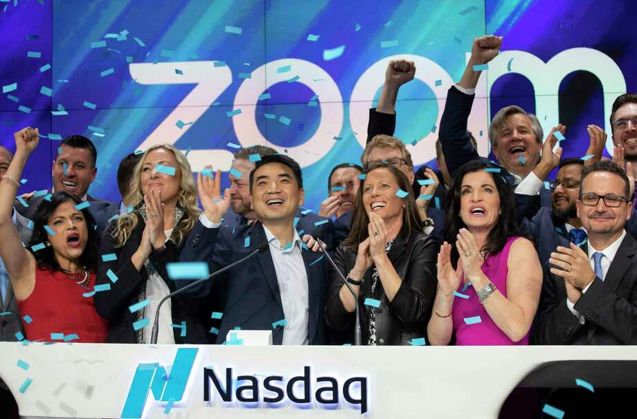 Zoom CEO Eric Yuan, center, celebrates the opening bell at Nasdaq as his company holds its IPO, Thursday, April 18, 2019, in New York. The videoconferencing company is headquartered in San Jose, Calif. (AP Photo/Mark Lennihan) Photo: Mark Lennihan / Copyright 2019 The Associated Press. All rights reserved.