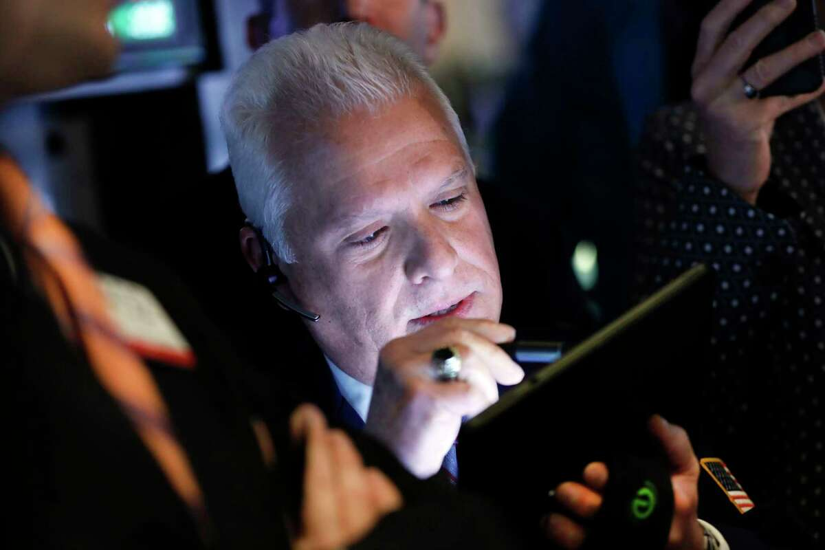 FILE - In this April 11, 2019, file photo trader Peter Castelli works on the floor of the New York Stock Exchange. The U.S. stock market opens at 9:30 a.m. EDT on Thursday, April 18. (AP Photo/Richard Drew, File)