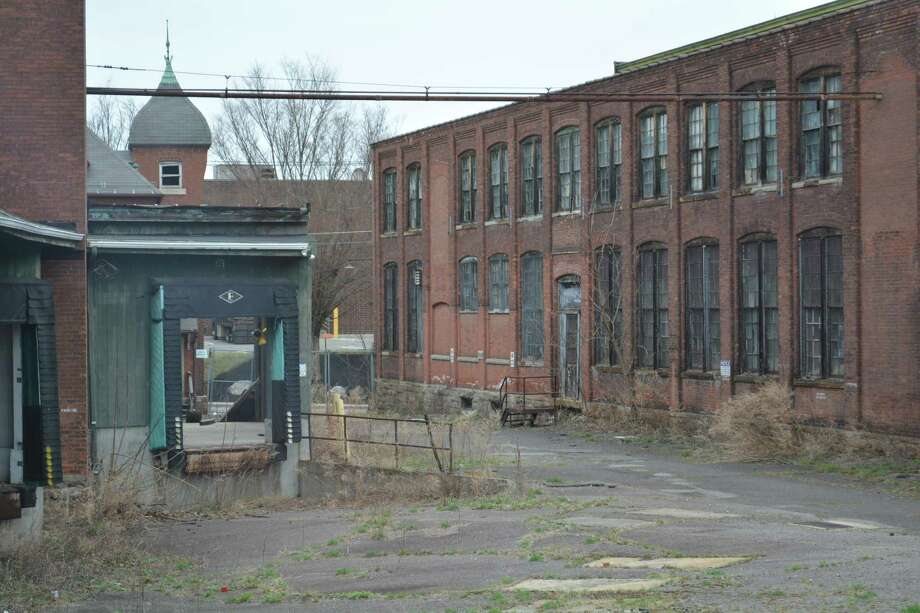 Two buildings at the former Stone Container Factory were slated to be auctioned over the weekend for back taxes. The state DOT asked for the property to be removed so it could bid at a later date. Photo: Leslie Hutchison / Hearst Connecticut Media /
