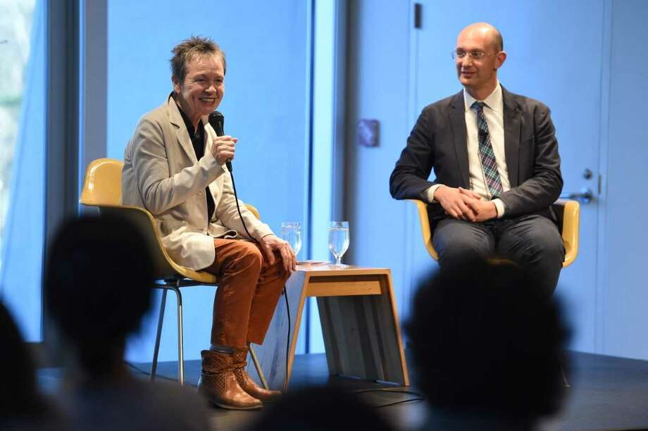 "Artist Laurie Anderson speaks with Benjamin Bogin, the Director of Skidmore College's Asian Studies Program, April 17, 2019, about the bardo, the intermediate phase between death and rebirth, during a Dunkerley Dialogue in conjunction with the exhibition ""The Second Buddha: Master of Time"" at the Frances Young Tang Teaching Museum and Art Gallery at Skidmore College. Tang Teaching Museum photo by Cindy Schultz."