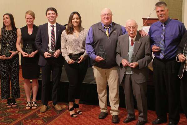 "Averill Park school district had its second annual Athletic Hall of Fame Induction Ceremony April 13 at Troy Hilton Garden Inn. In total, nine former Warriors were inducted, including seven athletes and two coaches. Accepting honors in the 2019 class of inductees are, from left, Suzanne Ernst Howell (1996), Mollie DeFrancesco Turner (1998), Suzie Snyder (2000), Jared Morine (2006), Abby Jackson (2004), Steven Allard (1983), ""Coach"" Earl Retzlaff, Ken Gunderman (1983), and Judy Mysliborksi (accepting on behalf of Paula ""Miss Mann"" Maniscalco, deceased). ""The best part of the entire evening was listening to each inductee talk about the impact that playing or coaching at Averill Park had on them, as well as the impact that athletics continues to have on them to this day,"" district Athletic Director Mark Bubniak said."