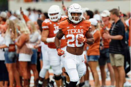 AUSTIN, TX - SEPTEMBER 08: Kirk Johnson #28 of the Texas Longhorns runs onto the field before the game against the Tulsa Golden Hurricane at Darrell K Royal-Texas Memorial Stadium on September 8, 2018 in Austin, Texas. (Photo by Tim Warner/Getty Images)