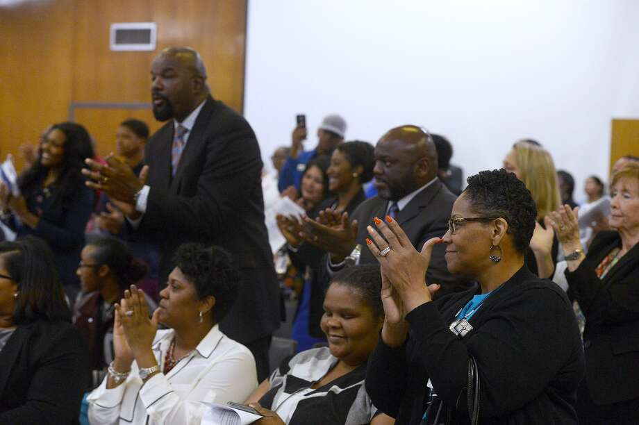 Audience members applaud after Denise Wallace-Spooner and Nathan Cross are sworn in as trustees during the Beaumont ISD meeting on Thursday night.  Photo taken Thursday 2/15/18 Ryan Pelham/The Enterprise Photo: Ryan Pelham / Ryan Pelham/The Enterprise / ©2017 The Beaumont Enterprise/Ryan Pelham