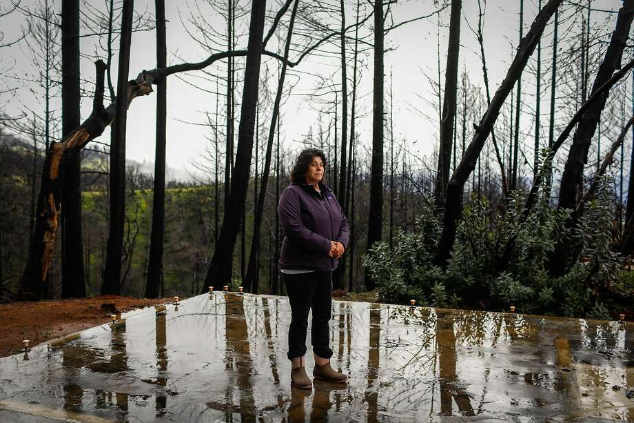 Sara Shepherd, in March, visits what used to be her home before the Redwood Valley Fire destroyed it in 2017. She sustained major burn injuries after getting trapped in the fire with her family. Sara and her husband, Jon, survived, but their children, Kai and Kressa, died. Photo: Gabrielle Lurie / The Chronicle