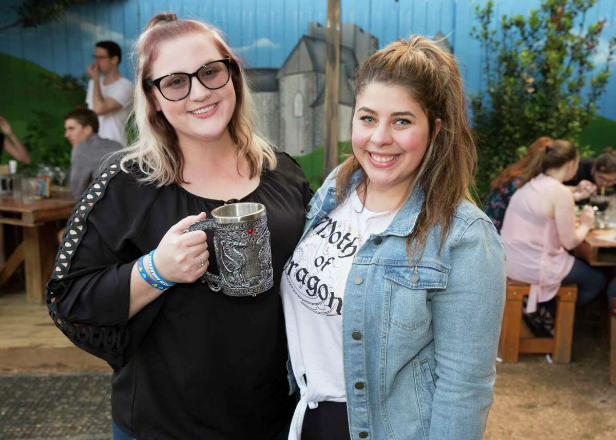 People pose for a photograph at the Game of Thrones Trivia at King's BierHaus on Thursday, April 18, 2019, in Houston.
